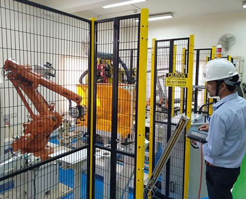training Trainee working on ABB Material Handling application