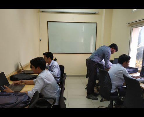 training Trainees working in Cim Station Robotics Simulation software 1