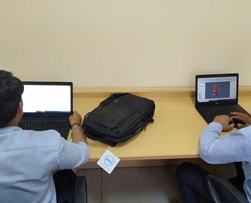 training Trainees working in Cim Station Robotics Simulation software 2