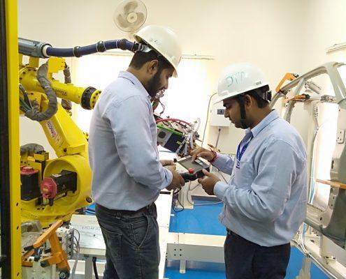 training Trainees working on Fanuc spot welding application