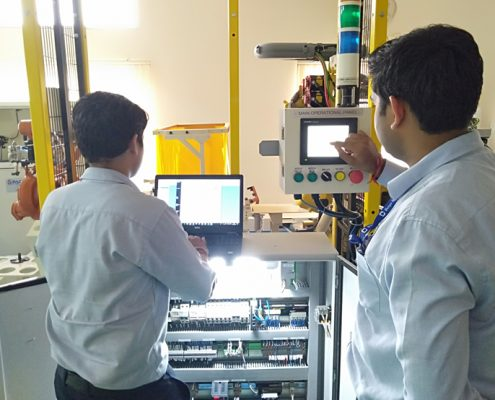 training Trainees working on PLC HMI to control the Robotic Cell